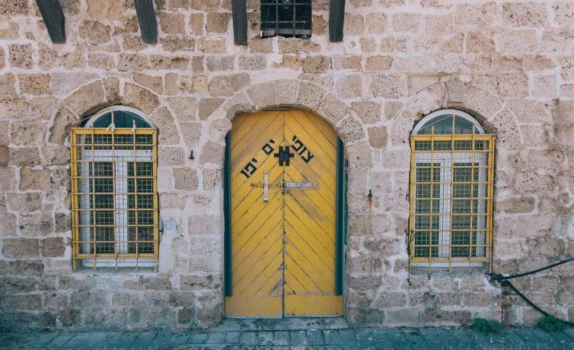 brown concrete building with brown wooden door